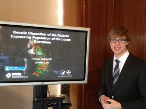 Forrest presenting his research at another competition.